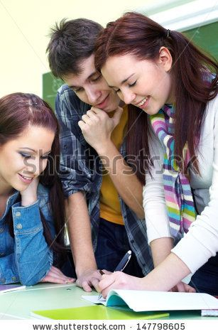 Group of students discussing in classroom