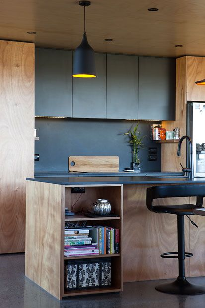 Box™ | KITCHEN | Gaboon ply with Black melamine cupboards and a Hoop Pine ceiling.