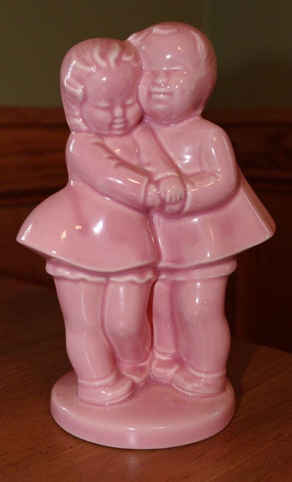 Vintage Shawnee Pottery Pink Toddler boy girl vase planter. $13.95, via Etsy.