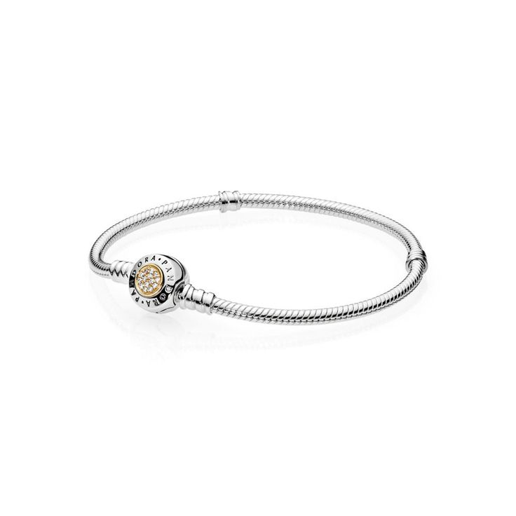 Moments Two Tone Bracelet With Signature Clasp | PANDORA, Colour: No ColourMaterial: No other materialMetal: Two ToneStone: Cubic ZirconiaThe classic PANDORA charm bracelet is updated with a spherical clasp featuring the iconic brand logo and a circle of shimmering stones. Made from sterling silver and lustrous 14 ct gold, it is a timeless two-tone carrier for your personal edit of charms, CA$104.98 26% OFF, Buy Now: http://www.pandoracanada2013.com/pandora-two-tone-bracelet.html