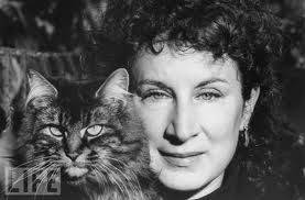 Margaret Atwood and her kitty posing for LIFE magazine; the similarity is striking.