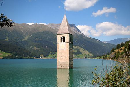 Resevoir Noir town of Reschensee, Italy and the 14th century church bell tower