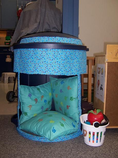 "Pinner says, ""I created a ""Safe Spot"" out of a new garbage can. I used Clifford bone material to decorate it and pillows to make it more comfortable. Students can go to the ""Safe Spot"" to calm down, have some alone time, or just chill out with a book. I have a basket of materials for students to use, as well as visuals of stress buster strategies."":"