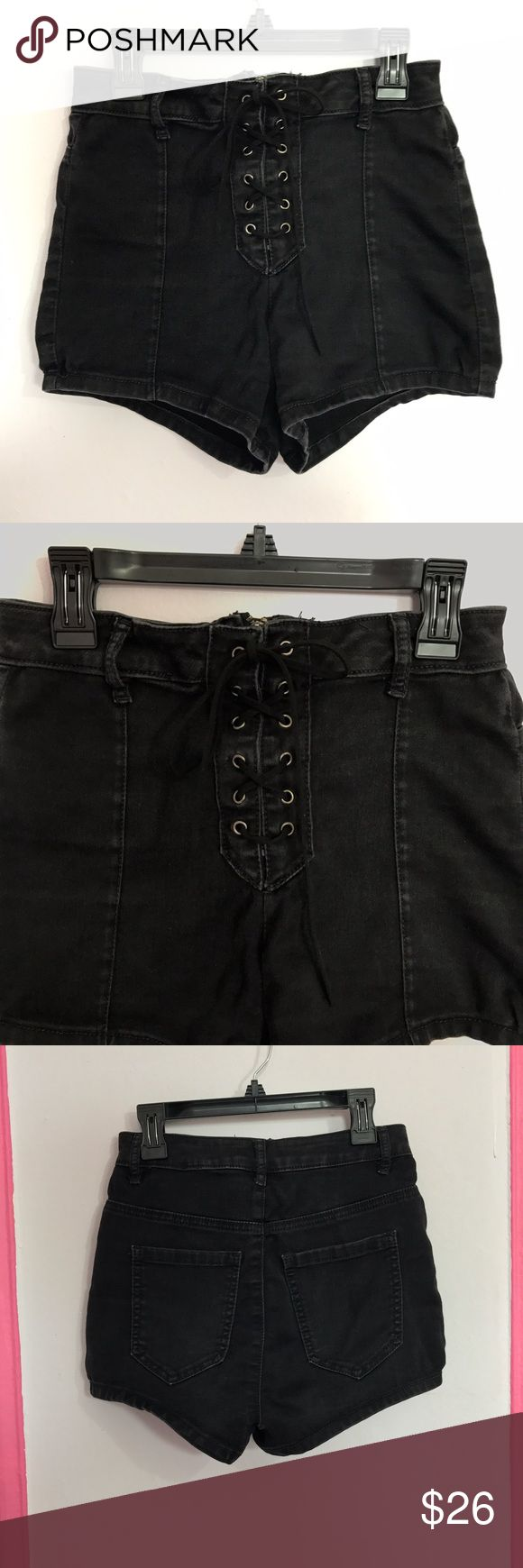 Black Lace Up Hot Shorts high waisted rocker boho Black stretch denim lace up shorts. In great preloved condition, with a little wear and some slight puckering in fabric on front, but flaws are unnoticeable & look vintage style. Faux suede Drawcord loops through silver grommets on front. Hidden zip up behind lace up detail. Size Small from Forever 21, I think it best fits a size 25 or 26. Perfect music festivals and rock concerts.  I accept reasonable offers  Bundle 2 + items to save 15% off…