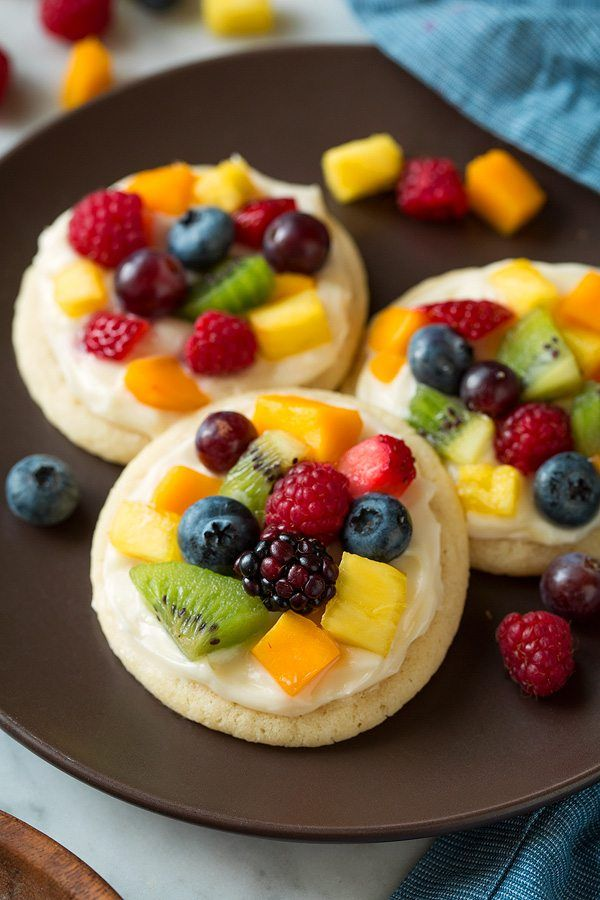 Individual mini fruit pizzas. Chewy sugar cookies are topped with cream cheese frosting and loaded with fruit for a delicious treat everyone will love!