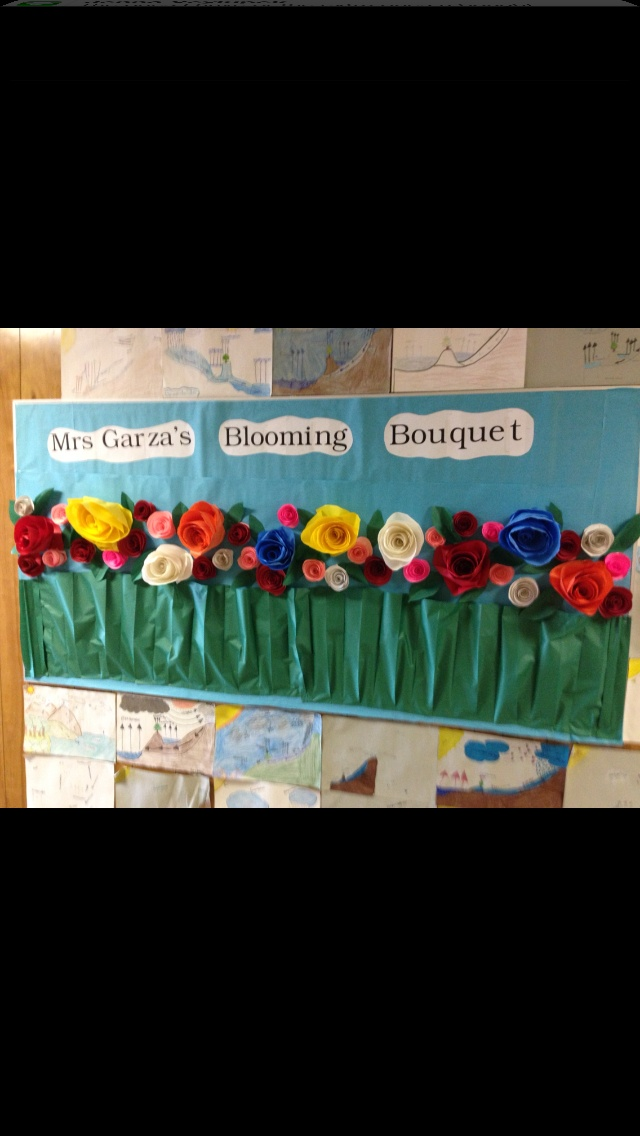 I decorated this board for my daughters class room for spring!  5 th grade  Had the kids in the class all make a flower!