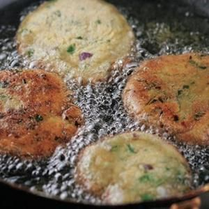 Potato Cakes with Cumin from Kitchen Daily - Top with red onions or your favorite chutney! Found at www.edamam.com.