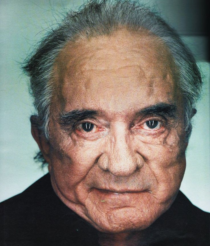 """I'd rather die than retire,"" Johnny Cash told Rolling Stone in November 2002.  ""Like a shark — got to keep moving.""  This portrait, taken in Cash's home by Martin Schoeller, captures the fierce optimism of The Man in Black, who passed away eleven months later. It's as honest a portrait as I've seen, and somehow, lurking in the wrinkles and lines and cloudy eyes, there's a great amount of humanity and humor still burning strong.  That's Cash."""