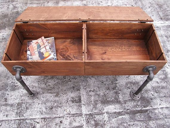 pipe legs, coffee table Materials: wood box, wine crate, caster wheels, crate, hairpin, hinge, casters, castors, cast iron, iron, wooden, distressed, piped