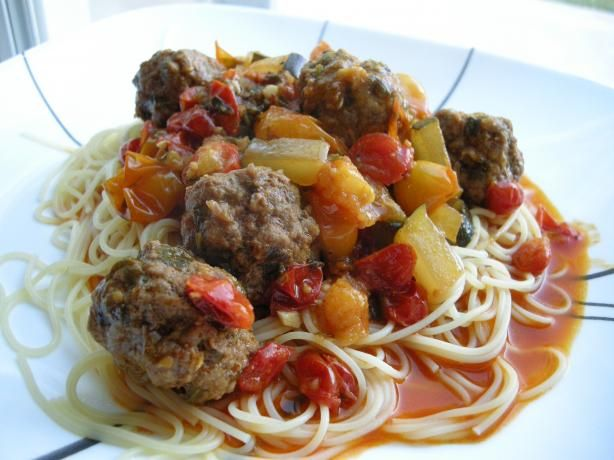 Moroccan Meatballs -- Tagine Kefta. Chopped tomatoes, paprika, cumin ...