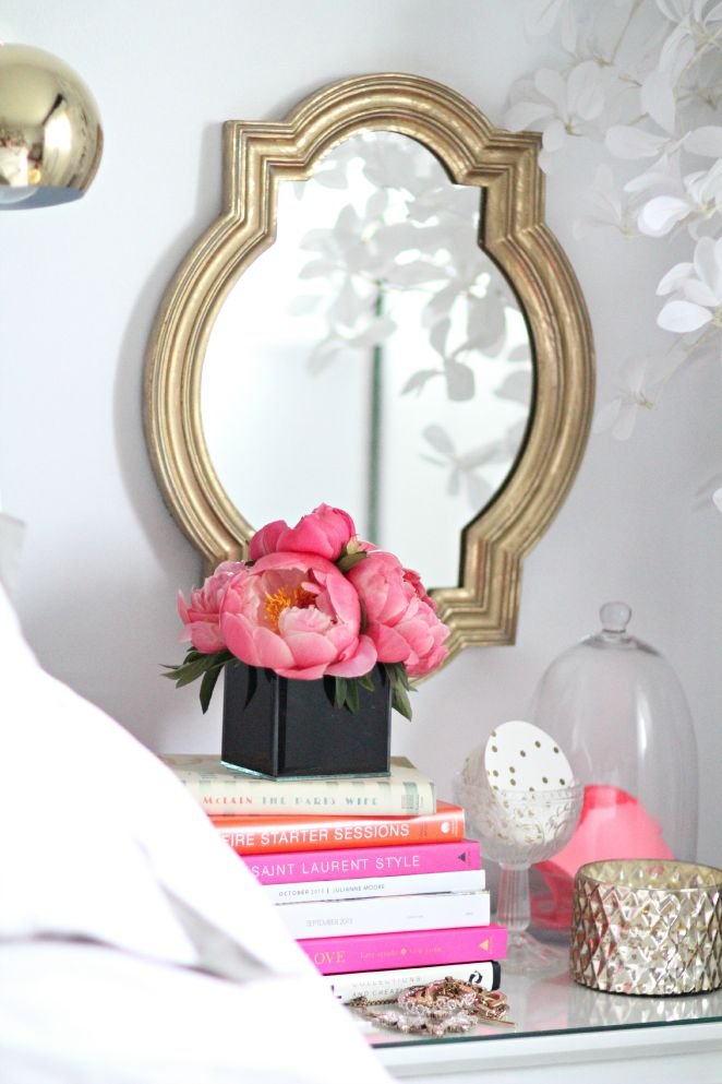 peonies on a stack of books