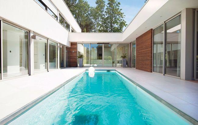 Reportage piscine dans patio piscine spas for Design piscine 47