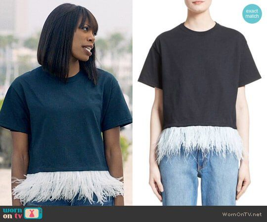 Molly's feather trim top on Insecure.  Outfit Details: https://wornontv.net/78133/ #Insecure