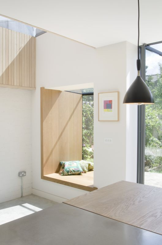 A Projecting Frameless Glass Box Oriel Window Seat with Timber reveals