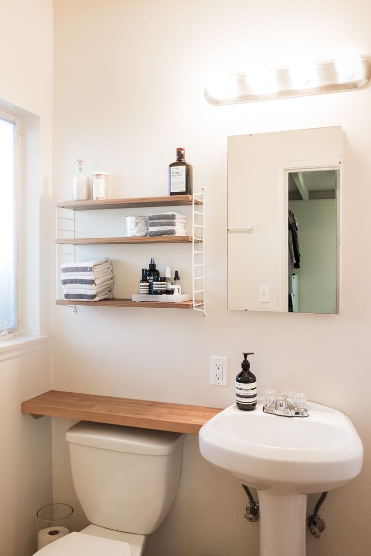 Small Space Bathroom Tips - 11 ways to clear clutter and 20 tips for living with a small space bathroom.