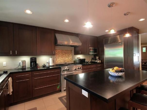 Photo of Brown Contemporary Kitchen project in Salt Lake City, UT by Renovation Design Group