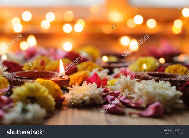 stock-photo-diwali-candles-and-oil-lamps-with-flowers-on-a-wooden-background-334727078.jpg (1500×1096)