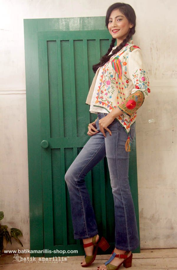 Batik Amarillis's New Arcana Jacket !AVAILABLE  at Batik Amarillis webstore www.batikamarillis-shop.com  It's very unique & stunning military cropped inspired jacket,this contemporary and yet vintage style is featured with exquisite Mexican embroidery on Raw Tenun Gedog Tuban plus beautiful embroidery adornments on shoulder and sleeve  it also features our  triangle arcana tassels to complete the whole extravangant work.