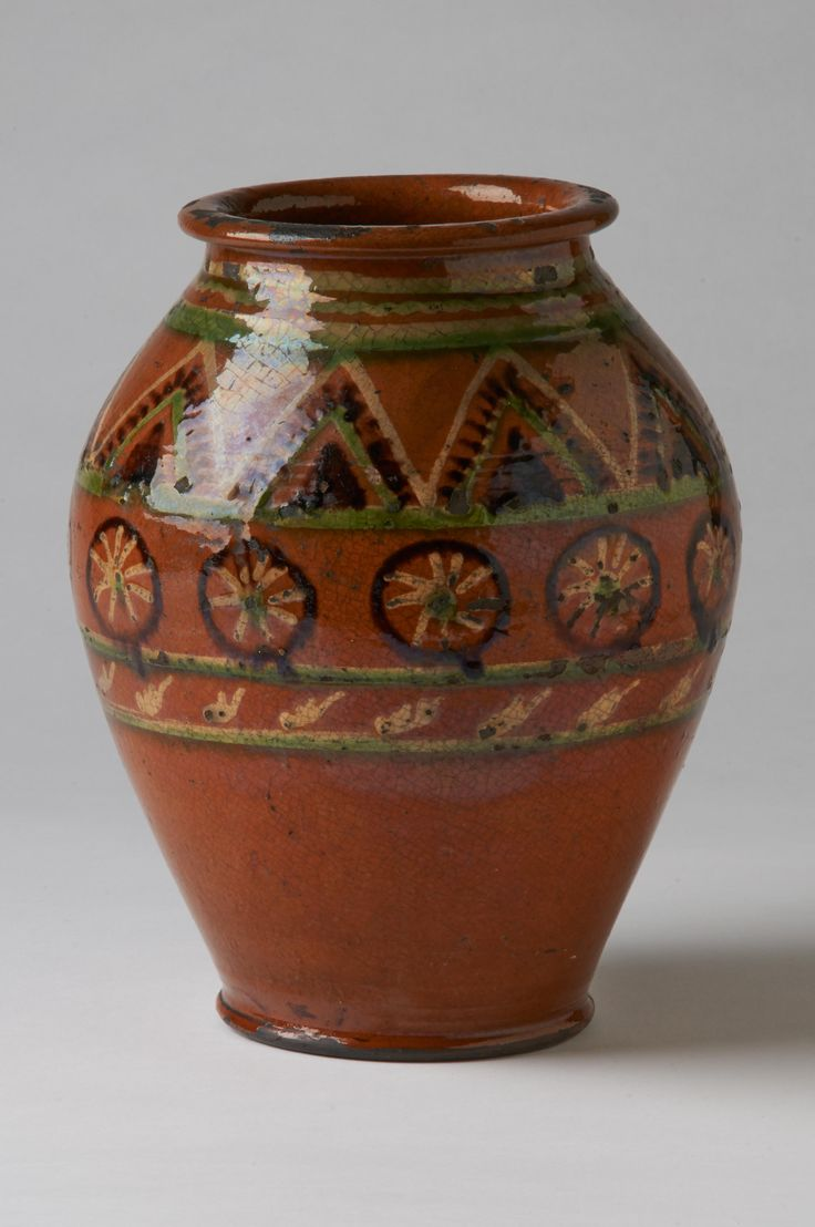 "Jar Dimensions: Ht. 8 ½""  Date / Circa: c. 1830  Maker / Origin: Possibly John Bell Chambersburg, PA  Medium: Glazed red earthenware  Miscellaneous: Minor glaze wear"