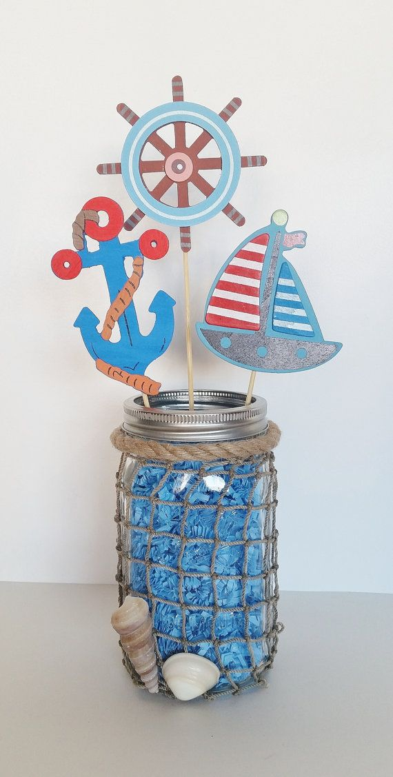Ahoy! These nautical mason jar centerpieces are perfect for a sailor or beach themed birthday party or baby shower. They are perfect for the center of a gift or guest table. This jar of this centerpiece measures 6 inches tall and is adorned with craft netting and sea shells. It