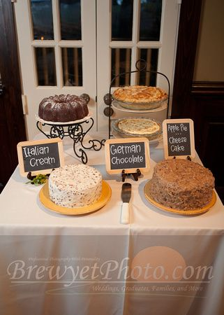 different cakes at grooms table