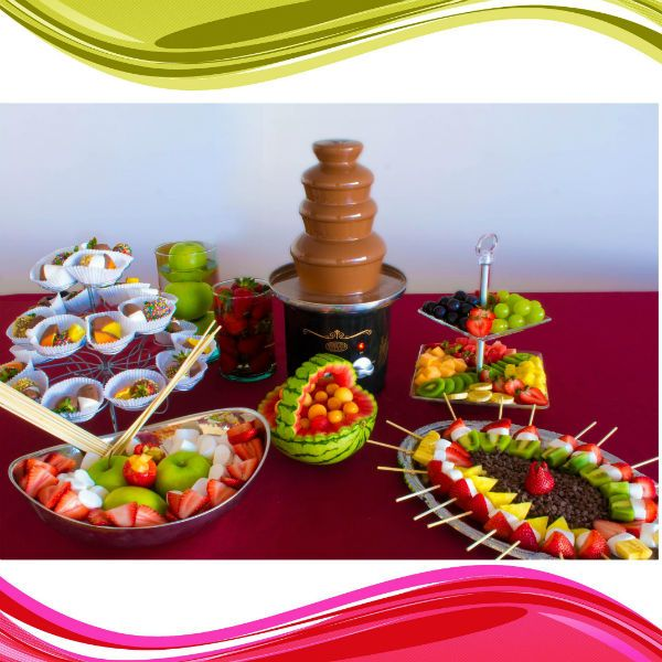 Alquiler de Fuentes de chocolate y decoración de mesa con pinchos y bocados de fruta www.enfrutados.com