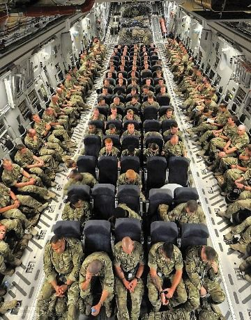 British troops onboard an RAF C-17 transport aircraft enroute to Camp Bastion in Afghanistan.