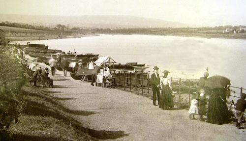 A photograph of families enjoying Roath Park