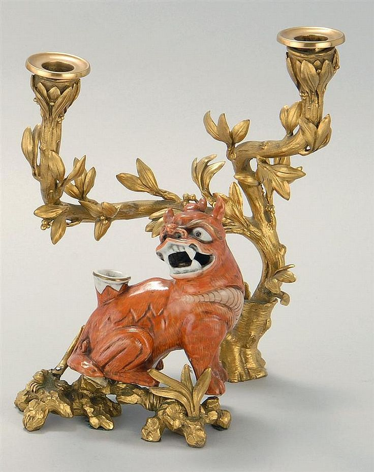 ORMOLU TWO-SOCLE CANDELABRA Mounted with a Chinese porcelain