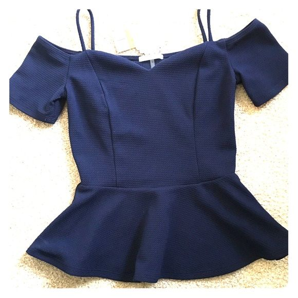 closet clear out Navy blue cute blouse Brand new with tags Navy blue blouse 100% polyester size S fit just right live the fact it make your waist look smaller super cute perfect for any party Soprano Tops Blouses