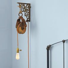 barn pulley light fixture tutorial....we did this in our master bedroom and I love the way it turned out!