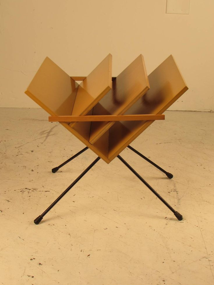 Unusual 1950s European Modern Magazine Rack with Hairpin Legs | From a unique collection of antique and modern magazine racks and stands at https://www.1stdibs.com/furniture/more-furniture-collectibles/magazine-racks-stands/