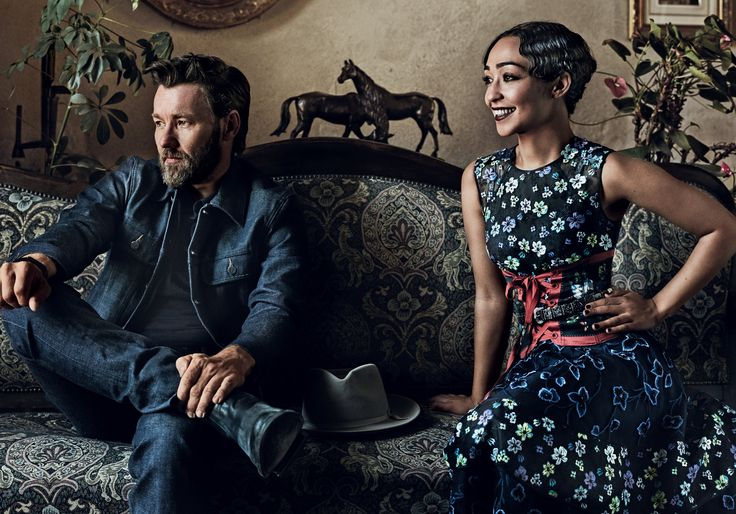 """Set Piece - """"How easy the door out of that marriage would have been,"""" Edgerton says. """"It was a door he never thought to go through."""" Oscar de la Renta dress; oscardelarenta.com. Alexander McQueen corset and belt. On Edgerton: A.P.C. jacket. Ermenegildo Zegna polo shirt. The Frye Company boots."""
