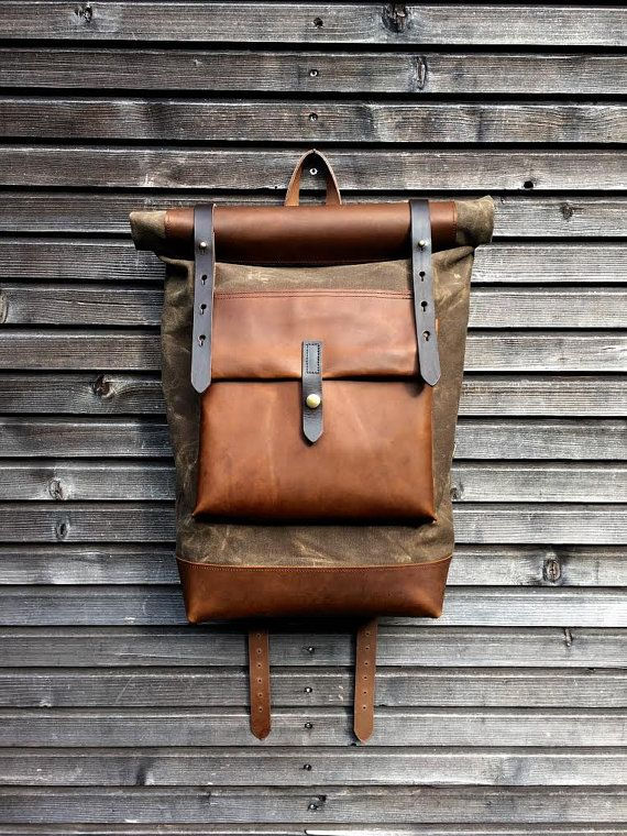 Waxed canvas backpack with roll up top and hand waxed leather bottom and outside pocket COLLECTION UNISEX