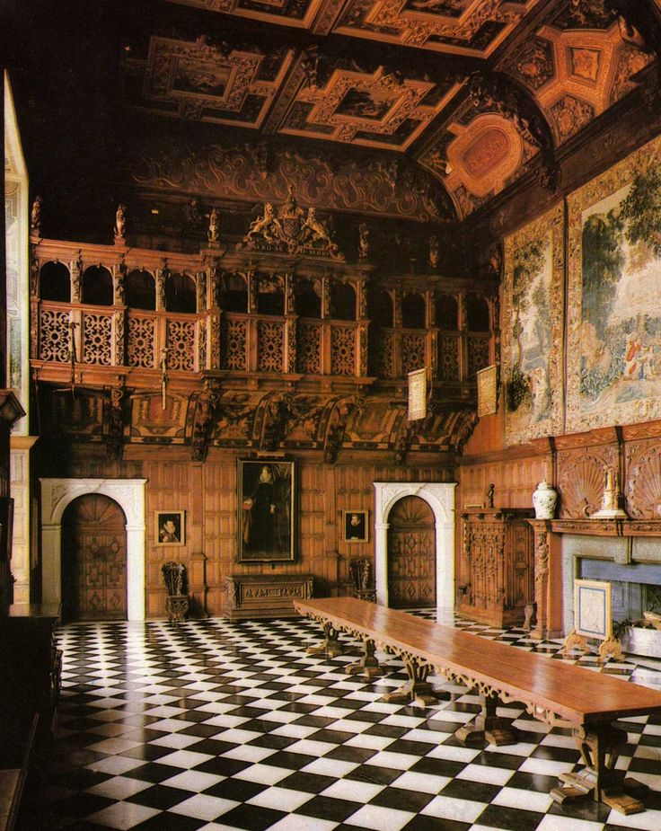 Magnificent Marble Hall in Hatfield House, Hertfordshire, England, UK. With its wonderfully extravagant oak carving by John Bucke, Marble Hall remains much as Robert Cecil, the 1st Earl of Salisbury, built it in 1611. Sometimes used as a dining room, it is the place where the Salisburys would entertain their guests with lavish banquets, dances and masques.