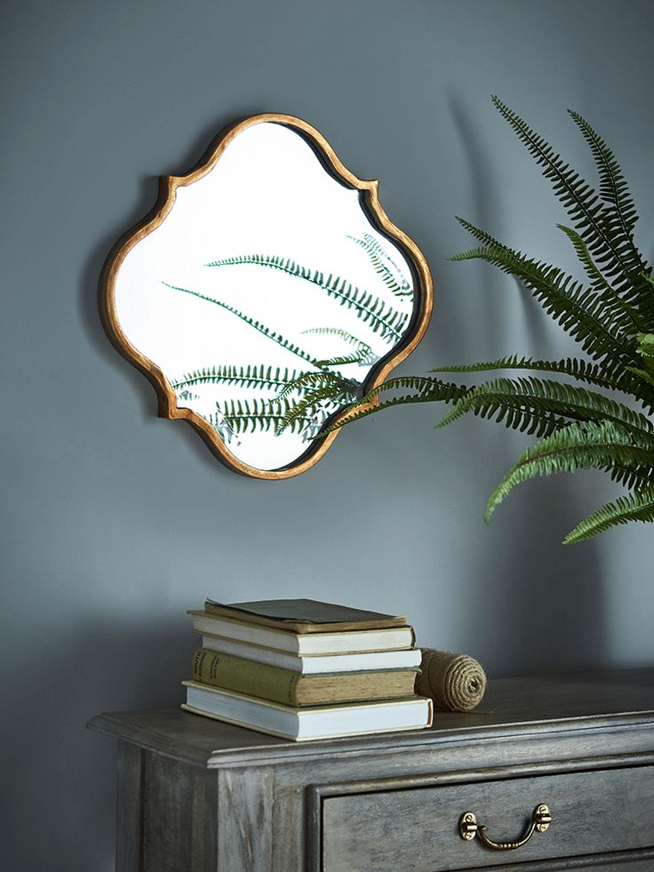 Made from lightweight metal with a warm metallic finish, this bevelled Moroccan style mirror has smooth curves that look great in a living or bedroom space. Why not team three together and create a statement wall?