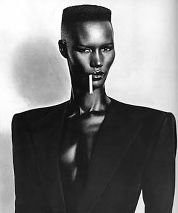 Grace Jones, Jamaican singer, actress & model. After modeling, she adapted an emerging electronic music style and adopted an androgynous look, which influenced the cross-dressing movement of the 80s. Her biggest hits are Pull Up to the Bumper, I've Seen That Face Before (Libertango), Private Life, Slave to the Rhythm & I'm Not Perfect (But I'm Perfect for You). She appeared in Conan the Destroyer with Arnold Schwarzenegger, Boomerang with Eddie Murphy and the James Bond film, A View to a…