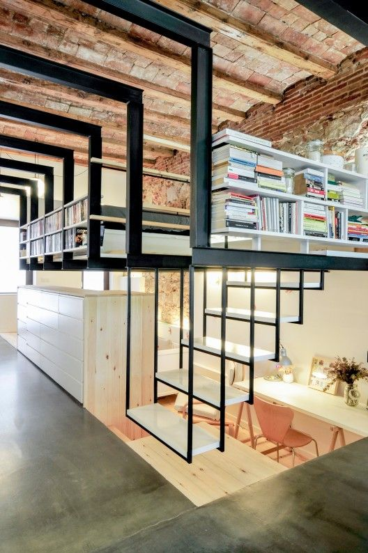 Love that the renovation of this building (turning it from a dry cleaning shop into a home) involved stripping it down to the original wooden ceiling beams and stone/brick walls
