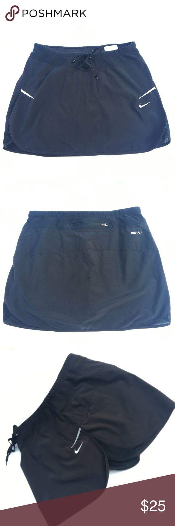"Nike Running Skort Mini Skirt Black Dri Fit XS WA7 Nike Women's Skorts Black Dri-Fit Running Skirt over Shorts, A Line, Reflective Swoosh and Sides.  Back Zipper Waist Pouch. Size: XS X Small  Waist: 12""  Inseam: 3.5"" Length: 11.75""  Condition: Very Good. Comes from a pet and smoke free environment!  Please review pictures and contact me if you have any questions. Color: Black Material: 86% Polyester, 14% Spandex Country: Singapore Style #: SU111103BOD Cut #: 364046-012 Care: Machine WT…"