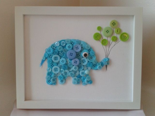 button animals glued to cardstock and framed for cute baby nursery art.