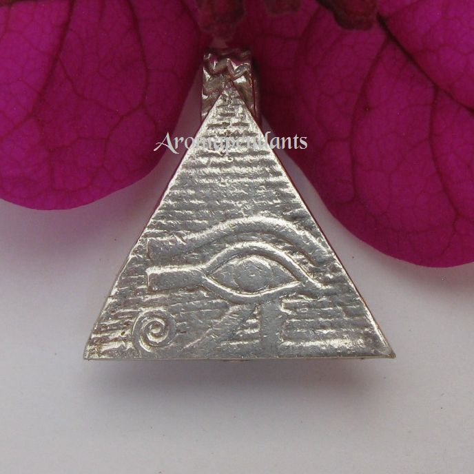 $60:00 Silver Eye of Horus on a pyramid background. Made by Julie Primmer