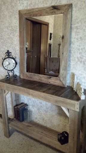 Beautiful Entryway table with matching mirror. The set is made with refurbished pallet wood $150. The set is available at Rustic Decor & More, located in Vincennes Indiana ~ 812-830-2820.