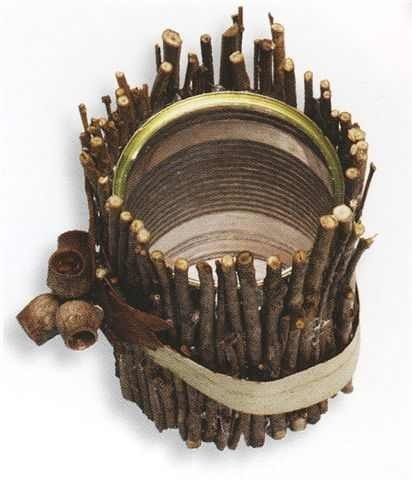 Take an aluminum can and hot clue twigs on it for a cute rustic look.. can be used as a simple decoration or add flowers