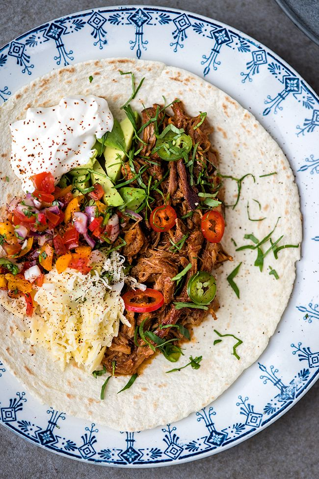 Mexican Slow Cooker Pulled Pork. Serve with tortillas, pico de gallo, avocado, grated cheese and sour cream - perfect for an informal meal with family and friends | supergolden bakes