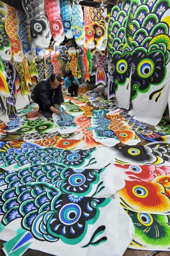 """A Japanese craftsman is making carp streamers called """"Koinobori (こいのぼり)"""", in preparation for the upcoming Tango no Sekku (端午の節句), a national holiday as Children's Day on May 5. Landscapes across Japan are decorated with koinobori from April to early May, in honor of sons and in the hope that they will grow up healthy and strong."""