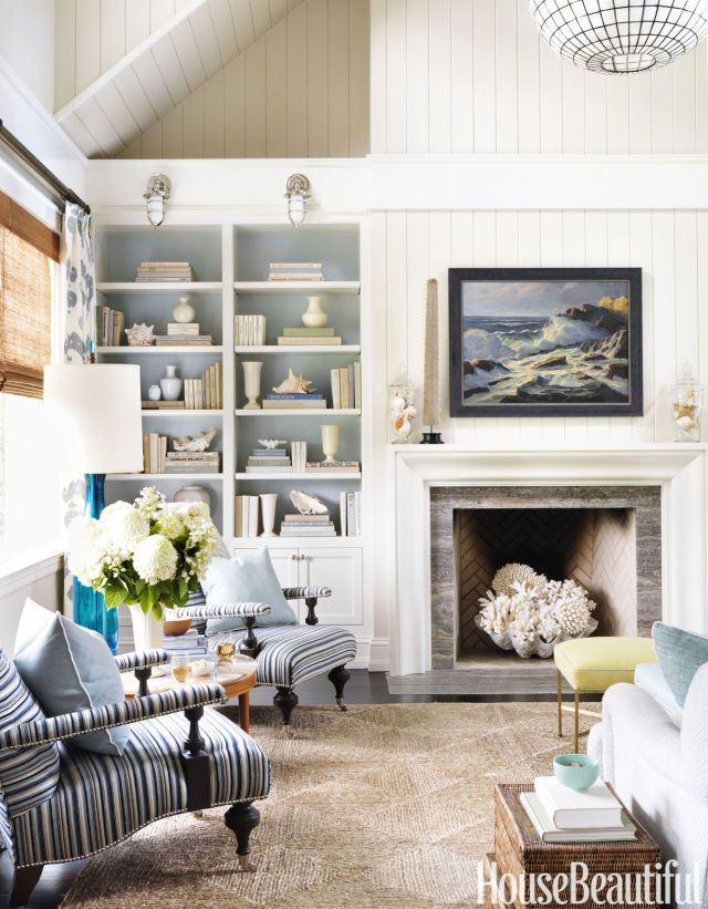 A great room was added to the house's original footprint. Armchairs in Bassett McNab's Chenille Stripe. Walls are painted in Benjamin Moore's Edgecomb Gray.   - HouseBeautiful.com