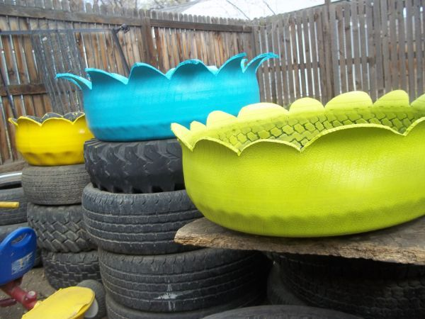 funky way of using old tires for planters in the yard visit like our