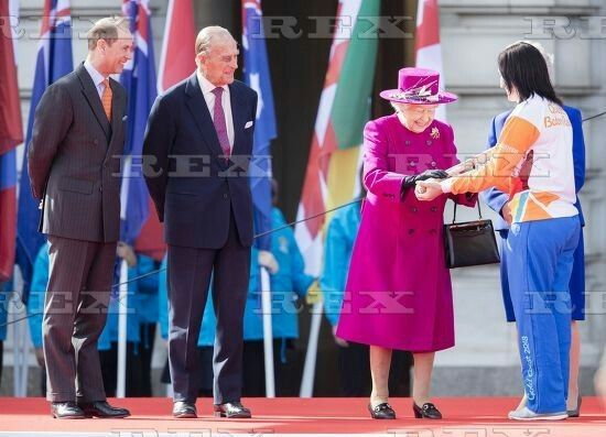 Commonwealth Baton Relay launch, Commonwealth Day, Buckinghan Palace, London, UK - 13 Mar 2017  Prince Edward, Prince Philip look on as Queen Elizabeth II hands the baton to Anna Meares as she launches The Queen's Baton Relay for the XXI Commonwealth Games being held on the Gold Coast from 4th-15th April 2018 on the Forecourt of Buckingham Palace on the morning of Commonwealth Day.  13 Mar 2017