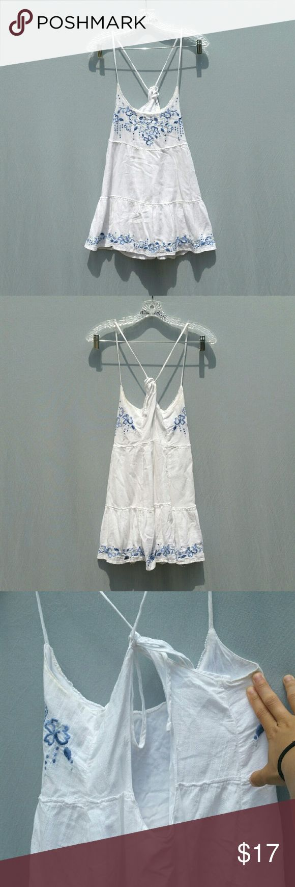 "Blue and white open back embroidered dress xs Worn once open back tie blue and white dress. Similar to a Jada dress. No flaws or stains.  Tag size : XS  Length : 30"" Center neck to hem: 20"" Loose fit. Petite fit. Abercrombie & Fitch Dresses Mini"