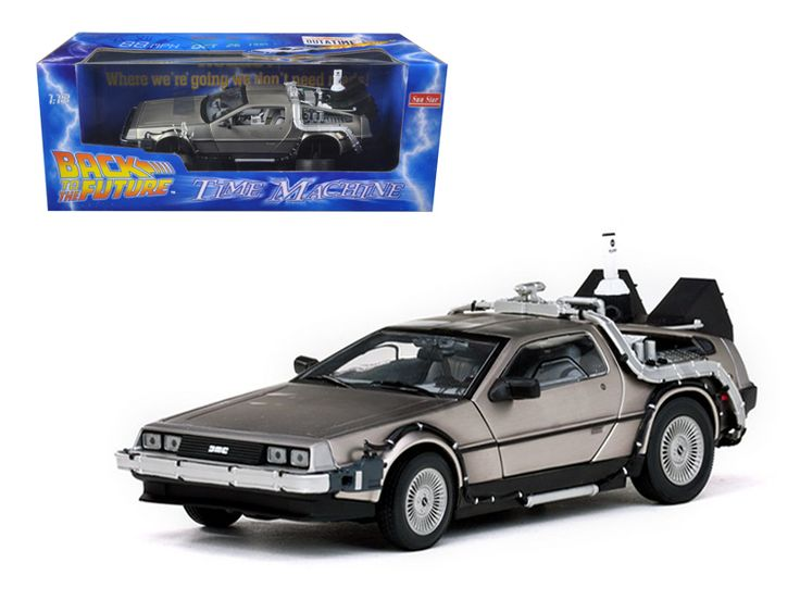 """Sun Star Delorean Time Machine From """"Back To The Future II"""" Movie 1/18 Diecast Model Car by Sunstar - Brand new 1:18 scale diecast Back To The Future Part II De Lorean by Sun Star. Brand new box. Rubber tires. Has opening hood and doors. Made of diecast with some plastic parts. Detailed interior, exterior, engine compartment. Dimensions approximately L-10, W-4, H-3.5 inches.-Weight: 4. Height: 8. Width: 15. Box Weight: 4. Box Width: 15. Box Height: 8. Box Depth: 7"""